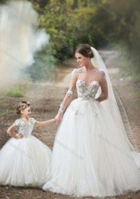 Feminine See Through Long Sleeves Luxurious Wedding Dresses with Appliques and Lovely Big Puffy Flower Girl Dress with Hand Made Flowers